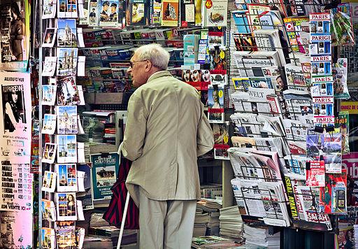 An_old_man_in_newsagent's_shop,_Paris_September_2011 (1).jpg