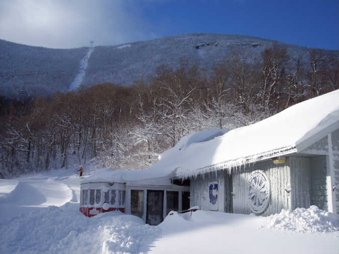 The New England Ski Museum, in Franconia, N.H.,in the appropriate time of the year. That's Cannon Mountain behind it.  The  Cannon Mountain Ski Area is state-owned and has nine lifts servicing 165 acres of skiing (158 with snowmaking). In the 1930s, the New Deal's  Civilian Conservation Corps  (CCC) cut six ski trails, some later incorporated into the Cannon Mountain Ski Area. The CCC and the Works Progress Administration (WPA) completed many attractive and useful public works during the Great Depression that are still with us.