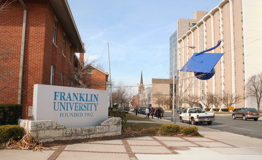 Franklin University, in Columbus, Ohio, features a giant steel mortarboard suspended over the street as a landmark.