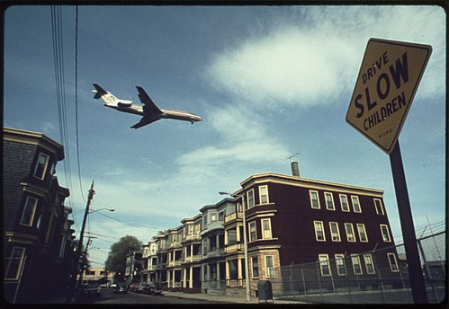 "An airliner descending to land at Logan International Airport, in East Boston, aka ""Eastie''."