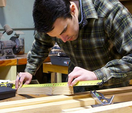 American College of the Building Arts junior measuring for a custom stair.