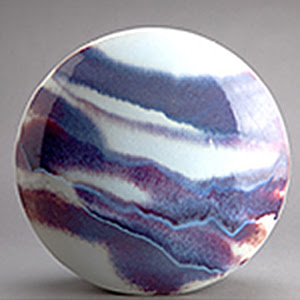 "Wheel vase, blue, purple, and opalescent white glaze, by Thomas Bezanson, a Benedectine monk, in his show ""Brother Thomas: Seeking the Sublime,'' at the Fuller Craft Museum, Brockton, Mass. The show includes a range of his pottery, from tea bowls to vases."