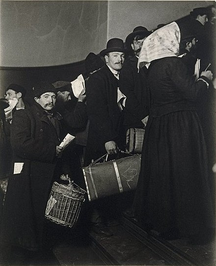 Immigrants arriving at Ellis Island about 1908.