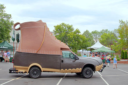 L.L.  Bean shoe car ( Bootmobile ) in Freeport, Maine, on July 7, 2012. Besides being the headquarters town  of Bean, Freeport has long hosted many outlet stores, some of them with high-end names. But some have struggled and even closed because of competition from Amazon, which has been destroying brick and mortar stores by the thousands across America. This has done a number on many Main Streets.    On a happier note, the Freeport area continues to have many fine seafood restaurants, as copious quantities of lobsters, clams, mussels and some species of finfish are still being pulled out of Casco Bay. (But cod are disappearing.....)
