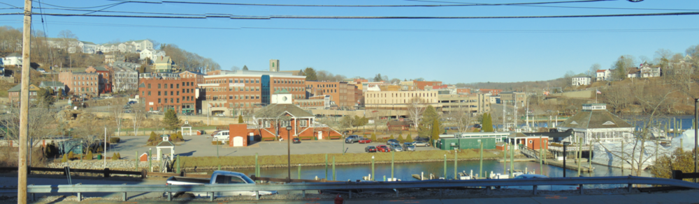 The rather gritty old mill town of Norwich, in  inland eastern Connecticut, which, with a few exceptions such as Pomfret and Brooklyn, is poorer than Fairfield and Litchfield counties in the west, which are enriched by New York City money, especially from Wall Street. Wally Lamb is from Norwich.