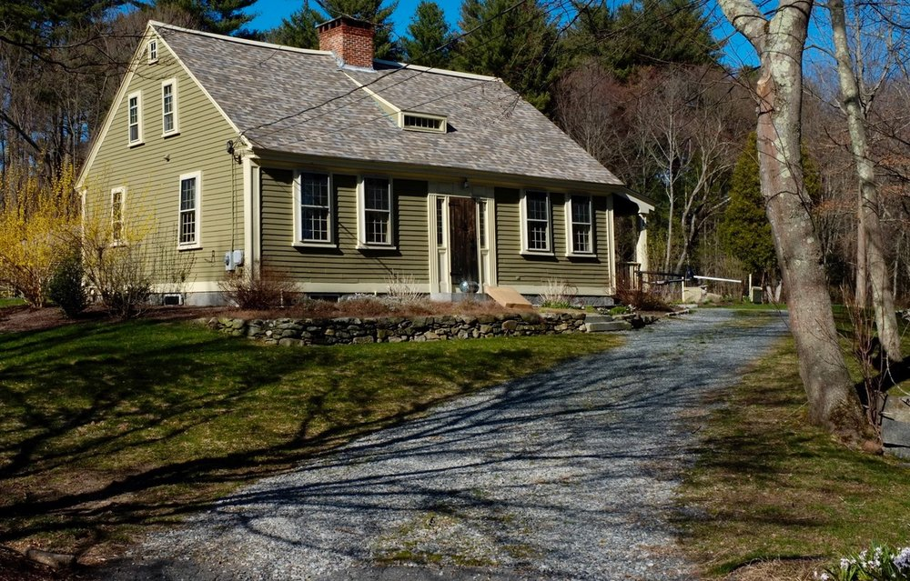 This Cape Cod cottage overlooking Abbott Run was built around 1800, but it got a Greek revival update in 1837.