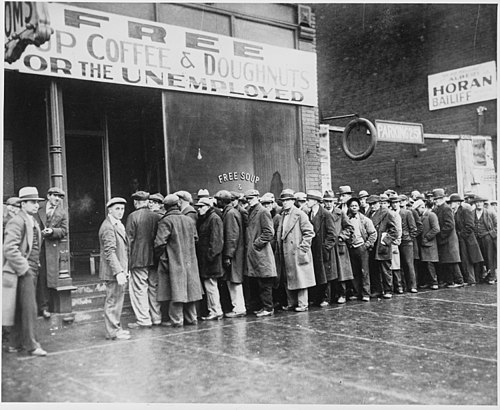 Unemployed men outside a  soup kitchen opened in 1931 by mobster  Al Capone  in Depression-era Chicago.