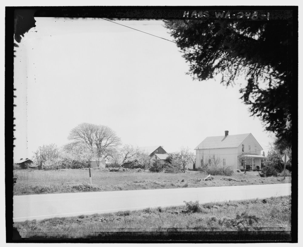 KINETH_FARM_FROM_ACROSS_HIGHWAY_20,_LOOKING_SOUTHEAST._The_Kineth_house_is_seen_on_the_right,_facing_the_highway._Behind_the_house_the_milk_house,_out_house,_and_a_chicken_coop_are_shown_HABS_WA-248-1.tif.jpg