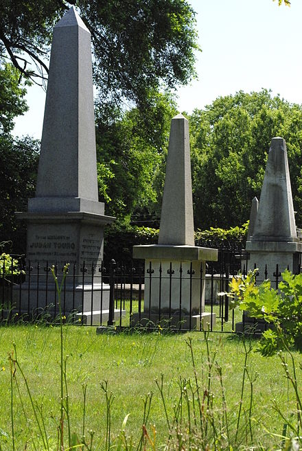 The Jewish Cemetery at Newport, dedicated in 1677 and also called the Touro Synagogue Cemetery. That synagogue, built in 1763, is the oldest surviving synagogue building in North America. It was built under the leadership of Cantor  Isaac Touro.