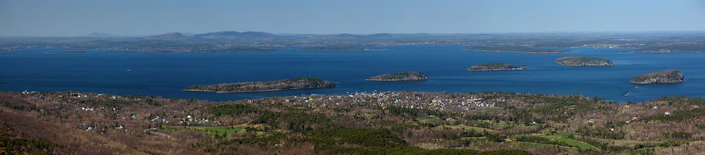 Frenchman's Bay, from the summit of Cadillac Mountain,  in Acadia National Park, Maine. The town below is Bar Harbor, a major tourist center, cruising-ship port and the home of the College of the Atlantic. Cadillac Mountain is the highest point on the U.S. coast between Canada to Mexico.
