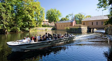 Tourists get a tour of the Lowell National Historic Park.