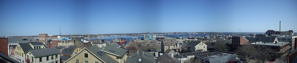 Looking over old houses and factories toward New Bedford Harbor.    — Photo by Gerrydincher