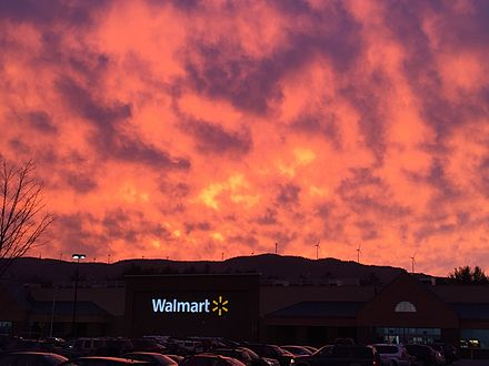 Sunset beyond the Plymouth Walmart. See the wind turbines on the ridge line.