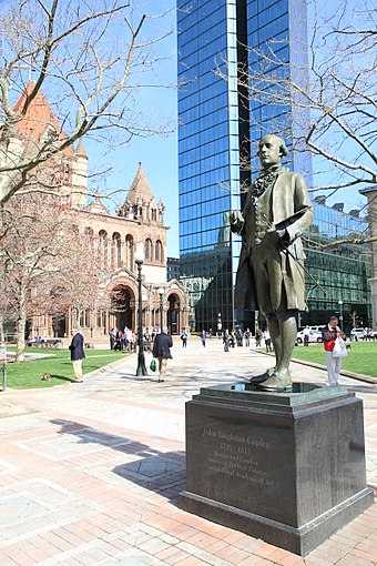Statue of Anglo-American painter John Singleton Copley (1738-1815) in Copley Square. In the background is the Hancock Tower and Trinity Church.