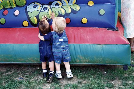 440px-Childhood_friends_at_a_carnival.jpg