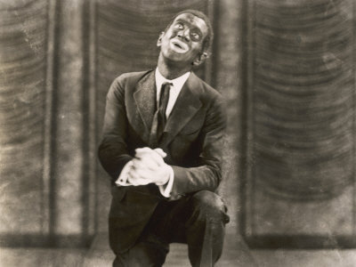 """White singer and actor    Al Jolson    wearing blackface in the musical film   The Jazz Singer   (1927). The movie was the first feature-length """"talkie''."""