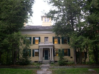 "The house, now a museum, in Amherst, Mass., where Emily Dickinson (1830-1886), the celebrated poet, lived most of her life. The town is famous for her and for hosting the flagship campus of the University of Massachusetts and Amherst College, a member of the ""Little Ivy League,'' along with Williams and Bowdoin colleges and Wesleyan University."