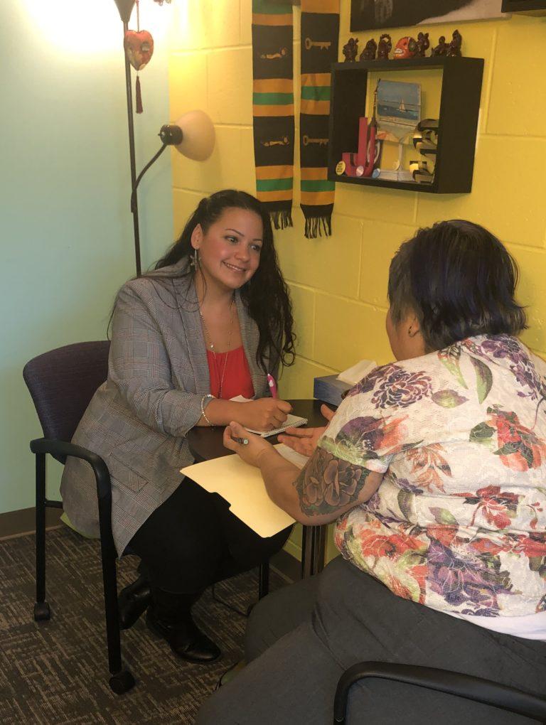 Jaydeen Santos helping a UVM student,