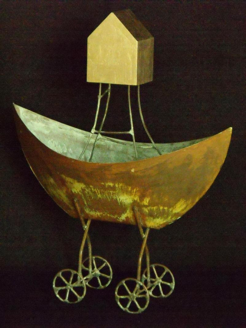 """""""Boat House'' (found metal and gold leaf), by Charles Gibbs, at the Andover Gallery Frame Shop, in Andover, Mass."""