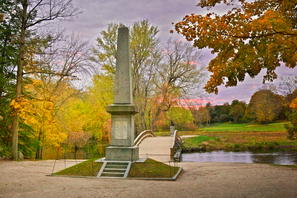 """The current version of the Old North Bridge in Concord, site of the first major battle of the Revolutionary War, on April 19, 1775, the date once marked as Patriots Day in Massachusetts, though it is now set for """"the third Monday in April.'' There was a less important skirmish earlier that day in Lexington, down the road. The monument here celebrates that day, as does Emerson's famous poem."""