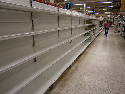 Empty shelves in a supermarket in Venezuela, which is led by socialist dictator Nicolas Maduro.
