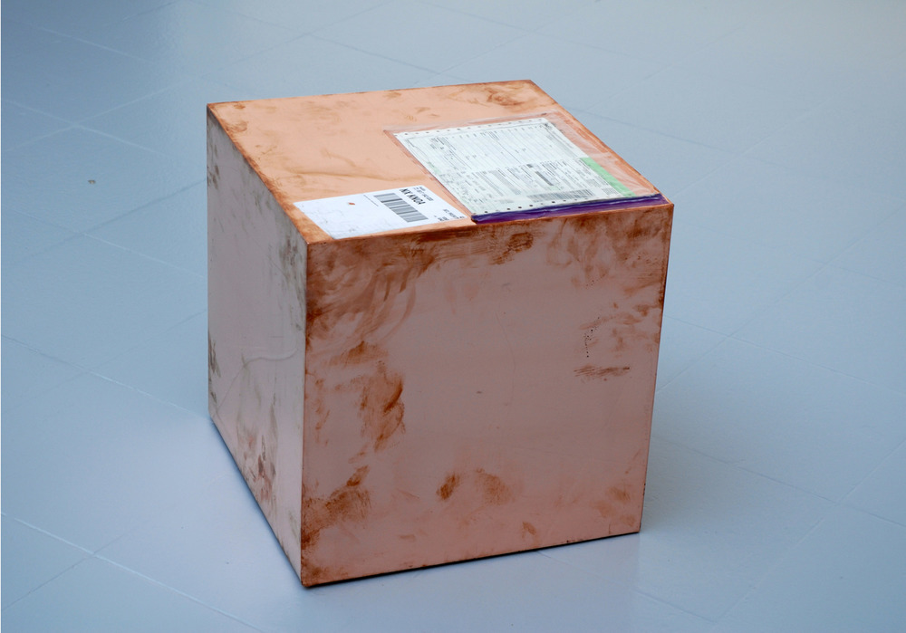 16-inch Copper (FedEx® Kraft Box  © 2005 FEDEX 330504 10/05 SSCC), International Priority, Los Angeles–Brussels trk#861718438308, August 31–September 2, 2011    2011–   Polished copper, accrued FedEx shipping and tracking labels  16 x 16 x 16 inches   FedEx Copper Works, 2009