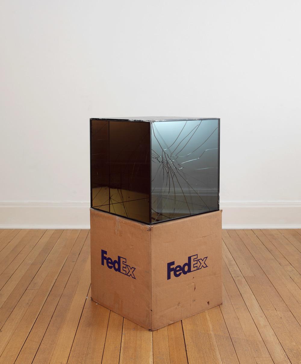 FedEx® Large Kraft Box  © 2008 FEDEX 330510 REV 6/08 GP, International Priority, Los Angeles–London trk#868587728072, October 02–05, 2009    2009–   Laminated Mirropane, FedEx shipping box, accrued FedEx shipping and tracking labels, silicone, metal, tape  20 x 20 x 20 inches   FedEx Glass Works, 2007–