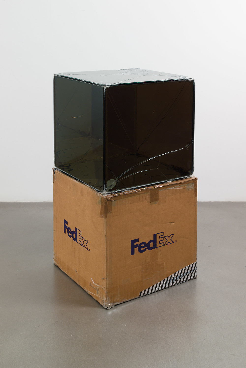 FedEx® Large Kraft Box  © 2005 FEDEX 330508 REV 10/05 SSCC, Standard Overnight, Los Angeles–Oak Park trk#865344981196, September 17–18, 2008, Standard Overnight, Oak Park–Los Angeles trk#865326699753, March 12–13, 2009, Standard Overnight, Los Angeles–New York trk#774901624186, November 4–5, 2015, Standard Overnight, New York–Los Angeles trk#775241295627, December 21–22, 2015    2008–   Laminated Mirropane, FedEx shipping box, accrued FedEx shipping and tracking labels, silicone, metal, tape  20 x 20 x 20 inches   FedEx Glass Works, 2007–