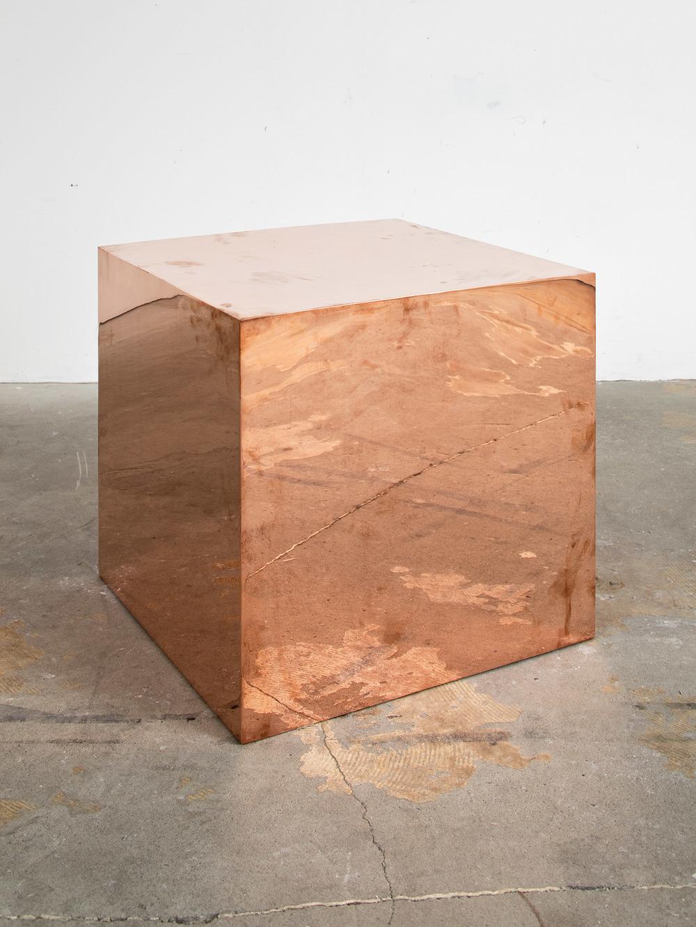 24-inch Copper (FedEx Large Kraft Box 2008 FEDEX 330510 REV 6/08 GP), International Priority, Los Angeles–Malmö trk#794379965566, February 2–4, 2011, International Priority, Malmö–Mostolés trk#871976834313, June 10–13, 2011, International Priority, Mostolés–Los Angeles trk#797697675646, November 3–8, 2011    2011–   Polished copper, accrued FedEx shipping, and tracking labels  24 x 24 x 24 inches   FedEx Copper Works, 2009–
