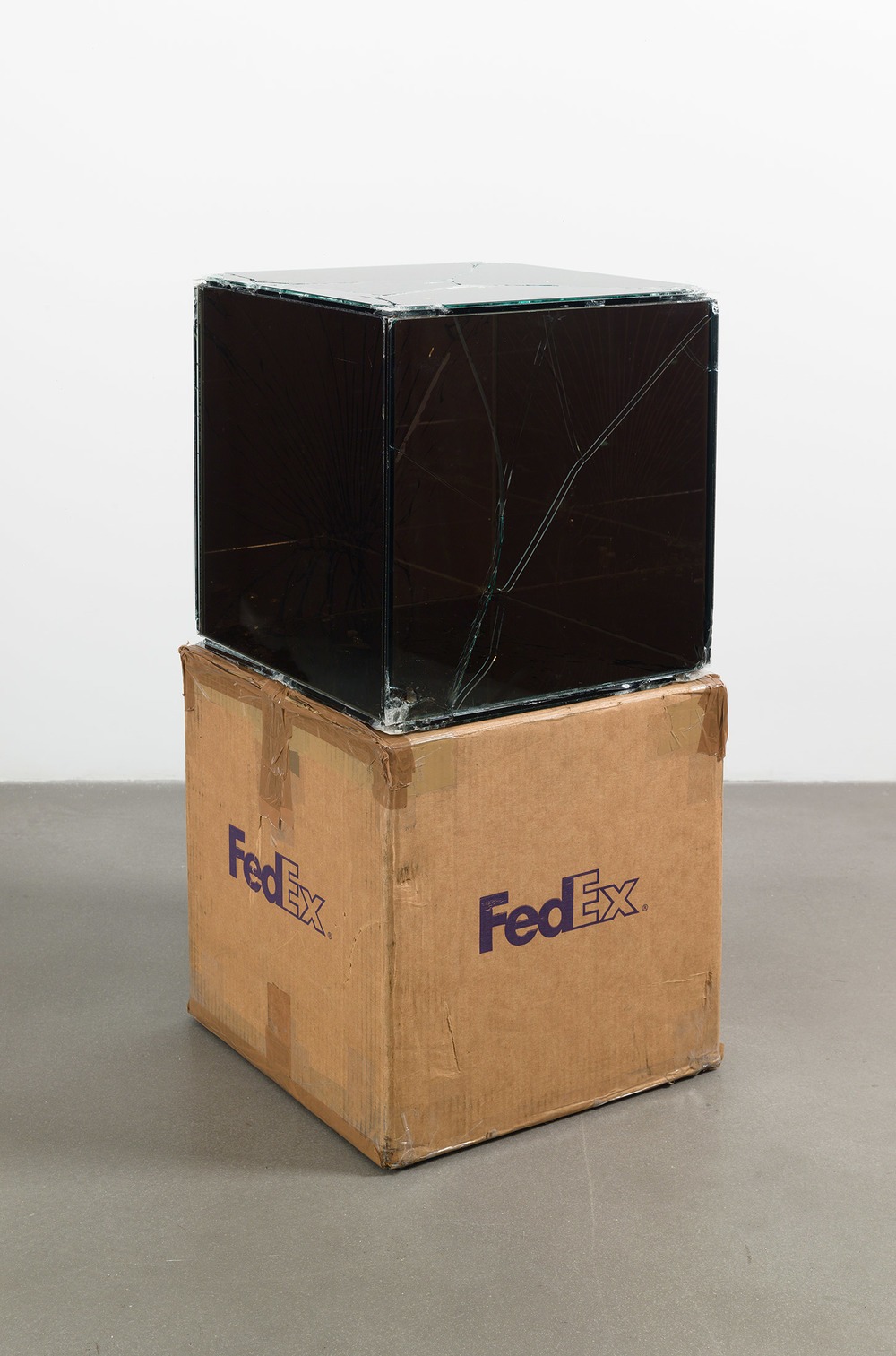 FedEx® Kraft Box  © 2005 FEDEX 330504 10/05 SSCC, Priority Overnight, Los Angeles–Miami trk#865344981303, October 29–30, 2008, Priority Overnight, Miami–Ann Arbor trk#861049125148, March 3–4, 2009, Standard Overnight, Ann Arbor–Los Angeles trk#868274625716, July 9–10, 2009, Standard Overnight, Los Angeles–New York trk# 774901718297, November 4–5, 2015, Standard Overnight, New York–Los Angeles trk#775241156204, December 21–22, 2015    2008–   Laminated Mirropane, FedEx shipping box, accrued FedEx shipping and tracking labels, silicone, metal, tape  16 x 16 x 16 inches   Pulleys, Cogwheels, Mirrors, and Windows, 2009    Great Hall Exhibition, 2015