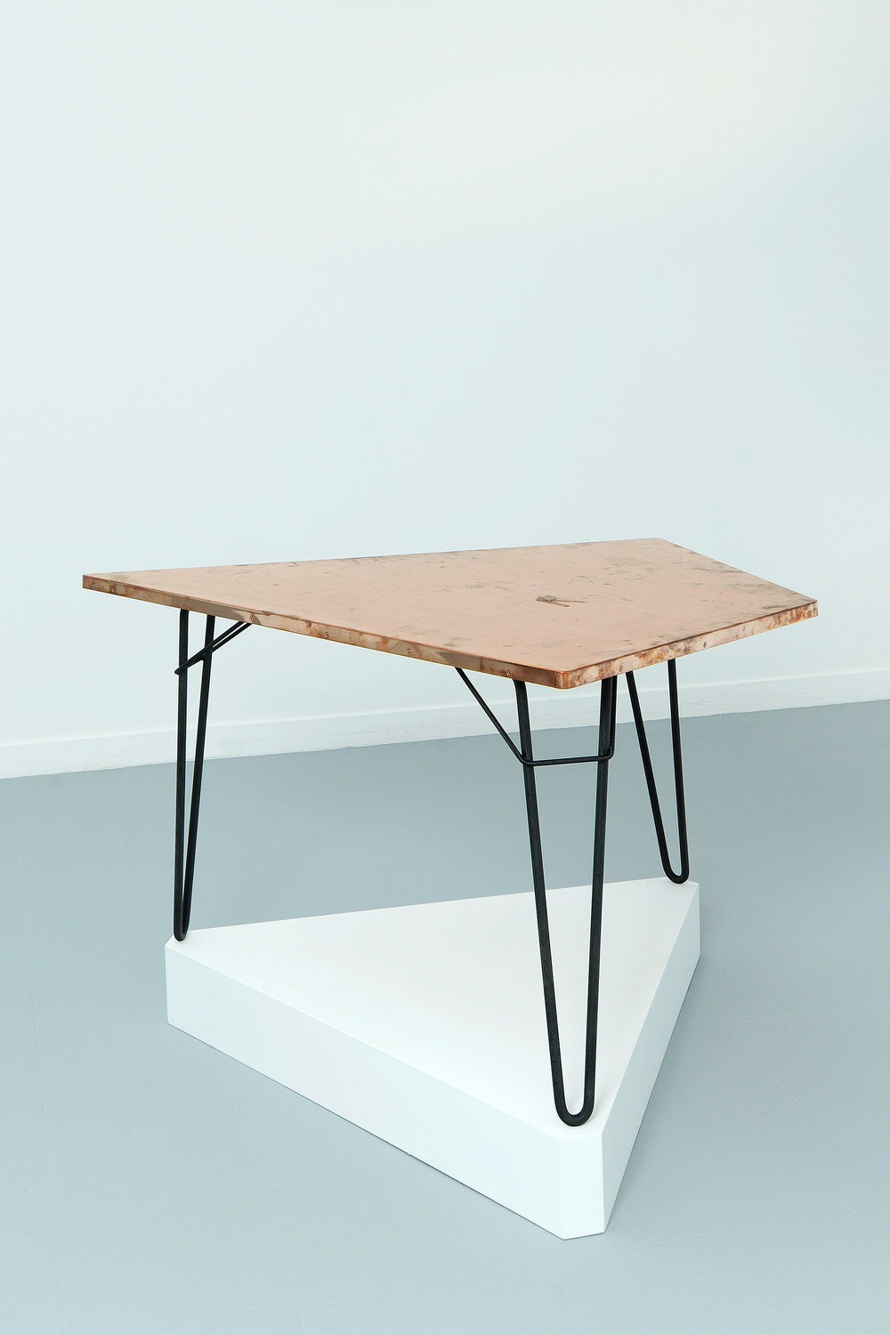Copper Surrogate (Table: designed by Willy Van der Meeren, 1958; Galerie Rodolphe Janssen, Brussels, Belgium, August 10th–September 2nd, 2011)   2011  Polished copper table top and powder-coat steel  Table: 39 3/4 x 26 1/2 x 1 inches   Surrogates (Tabletop and Desktop), 2008–    Diapositives, 2011