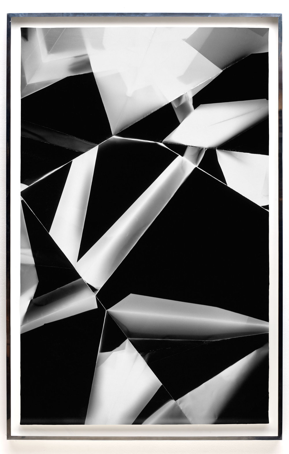 Fold (60º/120º/180º/240º/300º/360º directional light sources), June 5, 2008, Annandale-On-Hudson, New York, Foma Multigrade Fiber   2009  Black and white fiber based photographic paper  72 x 46 3/4 inches   Black and White Directional Folds, 2006–2014    Legibility on Color Backgrounds, 2009