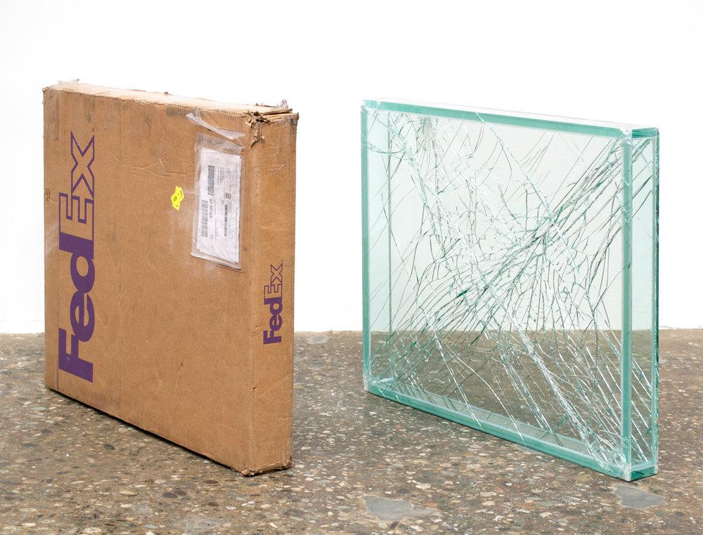 FedEx® Medium Framed Art Box  © 2011 FedEx 163095 REV 7/11 Standard Overnight, Los Angeles–New York trk#798452111018, May 30–31, 2012, Standard Overnight, New York–Los Angeles trk#793621540796, May 31–June 1, 2012    2012–   Laminated glass, FedEx shipping box, accrued FedEx shipping and tracking labels, silicone, metal, tape  28 x 33 3/4 x 4 inches