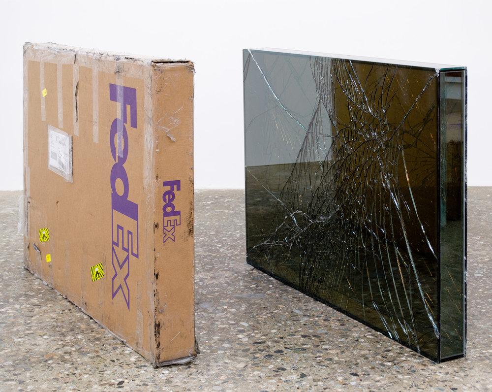 FedEx® Large Framed Art Box  © 2011 FedEx 163098 REV 7/11 Standard Overnight, Los Angeles–New York trk#793767809895, July 10–11, 2012, Standard Overnight, New York–Los Angeles trk#798598422030, July 11–12, 2012    2012–   Laminated Mirropane, FedEx shipping box, accrued FedEx shipping and tracking labels, silicone, metal, tape  36 11/16 x 49 3/8 x 4 3/4 inches