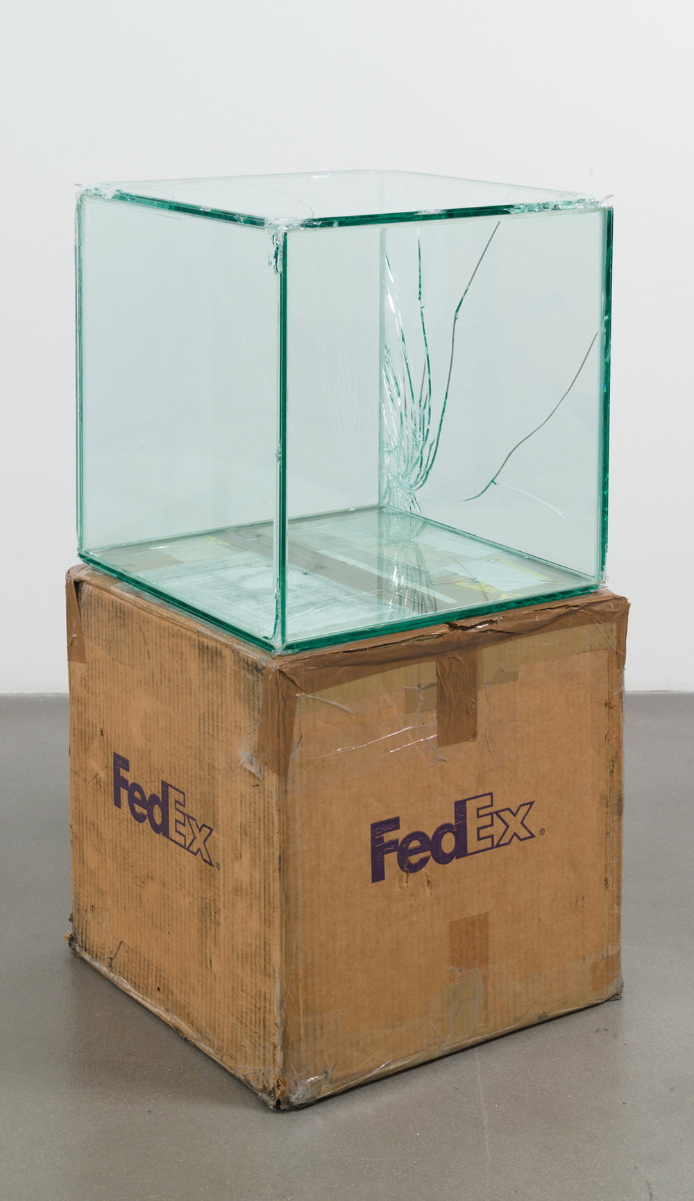 FedEx® Kraft Box  © 2005 FEDEX 330504 10/05 SSCC, Priority Overnight, Los Angeles–Miami trk#865344981347, October 29–30, 2009, Priority Overnight, Miami–Ann Arbor trk#861049125160, March 3–4, 2009, Standard Overnight, Ann Arbor–Los Angeles trk#868274625738, July 9–10, 2009, International Priority, Los Angeles–London trk#798269126180, April 10–12, 2012, International Priority, London–Los Angeles trk#875532113057, May 22–23, 2012, Standard Overnight, Los Angeles–New York trk#774901766211, November 4–5, 2015, Standard Overnight, New York–Los Angeles trk#775241327453, December 21–22, 2015    2009–   Laminated glass, FedEx shipping box, accrued FedEx shipping and tracking labels, silicone, metal, tape  16 x 16 x 16 inches   Travel Pictures, 2012    Great Hall Exhibition, 2015