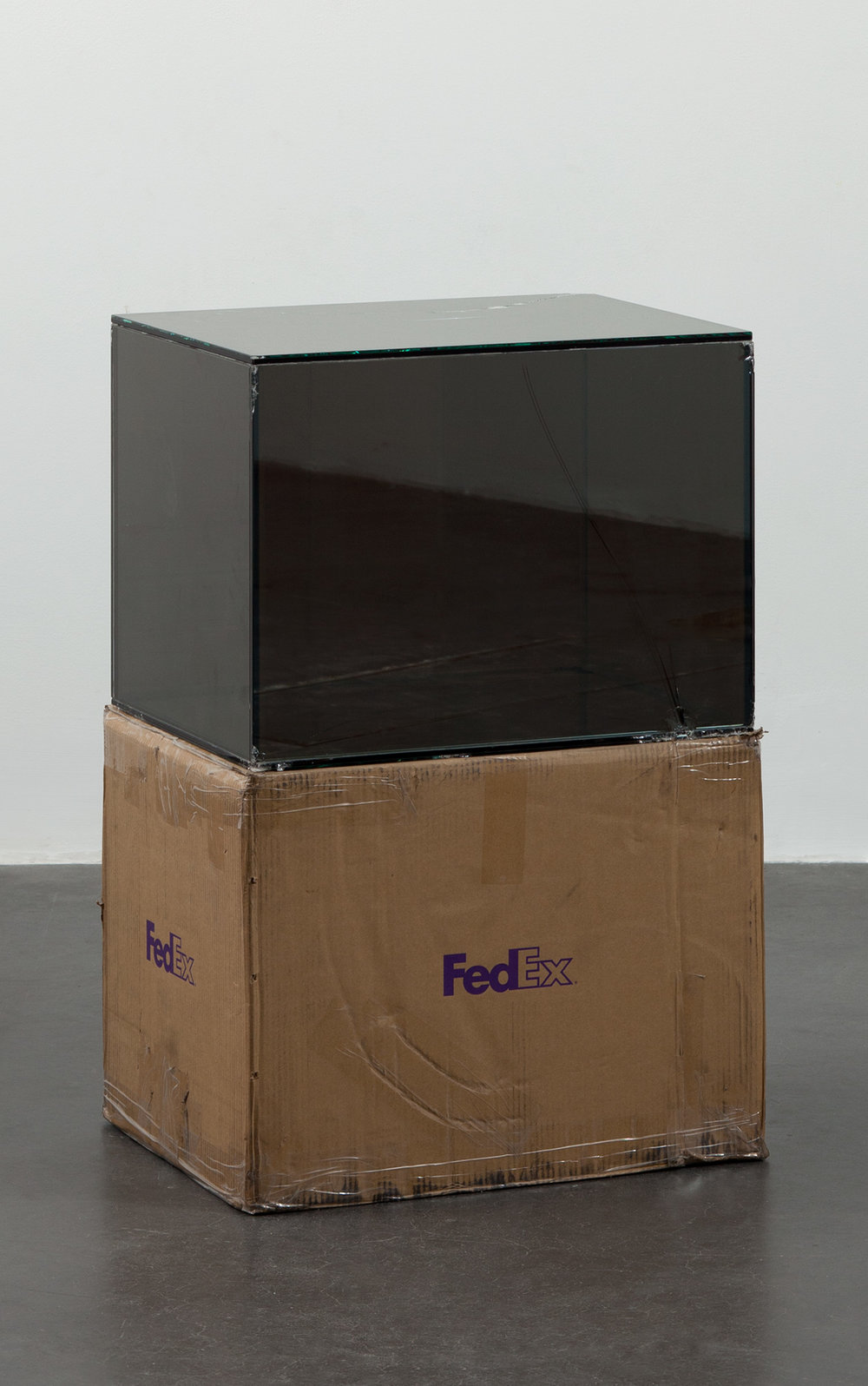 FedEx® Large Kraft Box  © 2004 FEDEX 155143 REV 10/04 SSCC, International Priority, Los Angeles–Beijing trk#875468976030, September 9–14, 2011, International Priority, Bejing–Paris trk#874594463967, March 13–15, 2012    2011–   Laminated Mirropane, FedEx shipping box, accrued FedEx shipping and tracking labels, silicone, metal, tape  23 5/8 x 18 1/2 x 18 1/2 inches   Securities and Exchanges, 2011