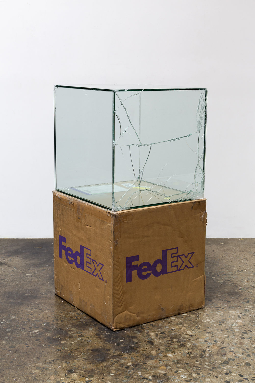 FedEx® Large Kraft Box  © 2008 FEDEX 330510 REV 6/08 GP, International Priority, Los Angeles–Tokyo trk#778608484821, March 9–13, 2017, International Priority, Tokyo–Los Angeles trk#805795452126, July 13–14, 2017    2017–   Laminated glass, FedEx shipping box, accrued FedEx shipping and tracking labels, silicone, metal, tape  24 x 24 x 24 inches   Transparencies, 2017