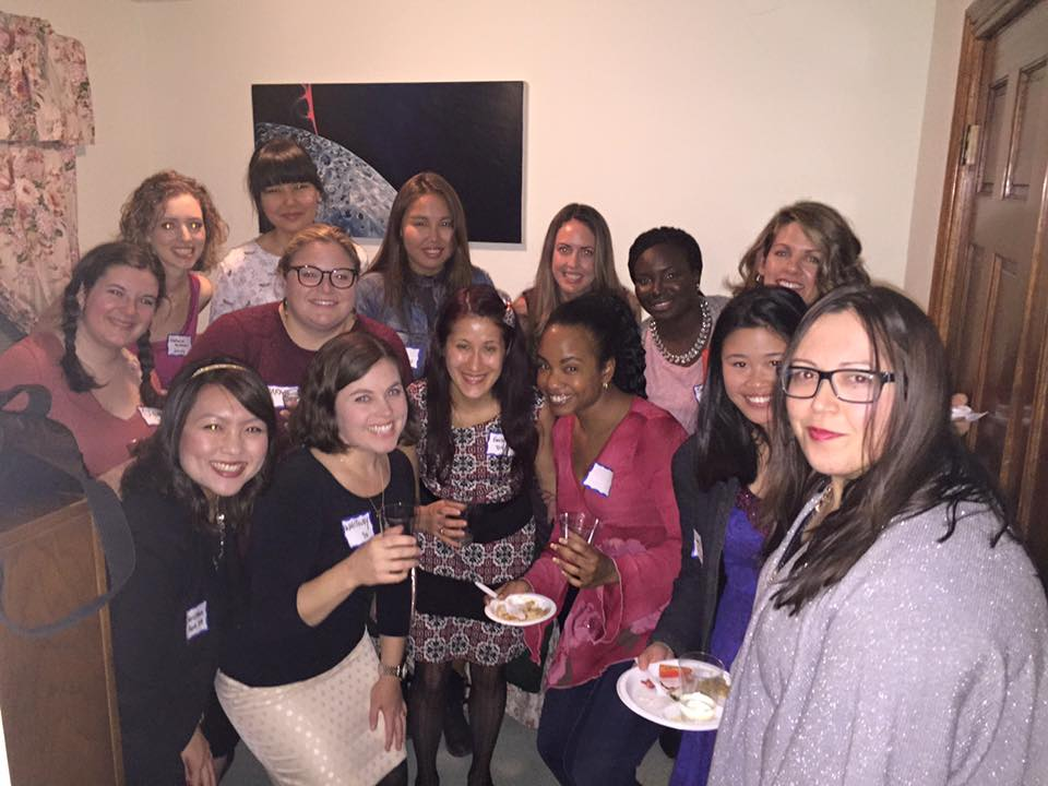 Young Alum Toast at Holiday Party