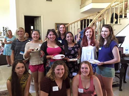 Incoming students meet current students at Spring Potluck Picnic and Pool Party
