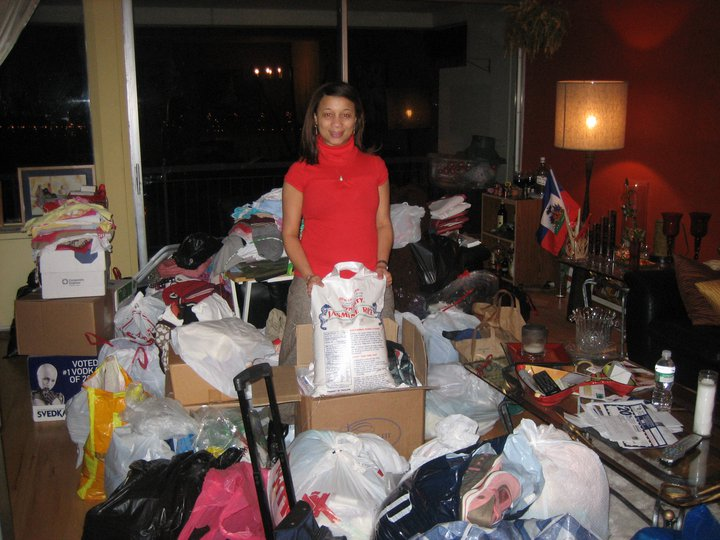 President & Founder of HHBS, Fran Juste collecting donations in her living room.
