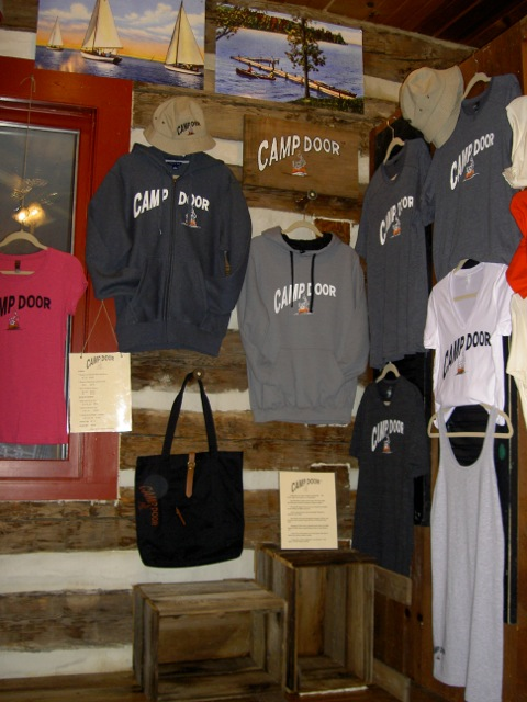 Camp Door Wear Pricing T-Shirts:   *  Women's in Charcoal, White and Garnet M, L, XL   $25.00 *  Women's Tank Dress in Heather Grey M & L   $35.00 * Men's T-Shirts in Charcoal M, L, XL   $27.00 2XL          $30.00   Hoodie Sweatshirts:   * Men's Pullover in Grey M, L, XL, 2XL   $49.00 * Juniors Pullover in Grey S, M, L, XL, 2XL   $79.00 * Full Zip Heavy Weight in Graphite S, M, L, XL, 2XL   $79.00   Canvas Tote   $85.00   Bucket Hat   $30.00     Please ask for assistance in sizing