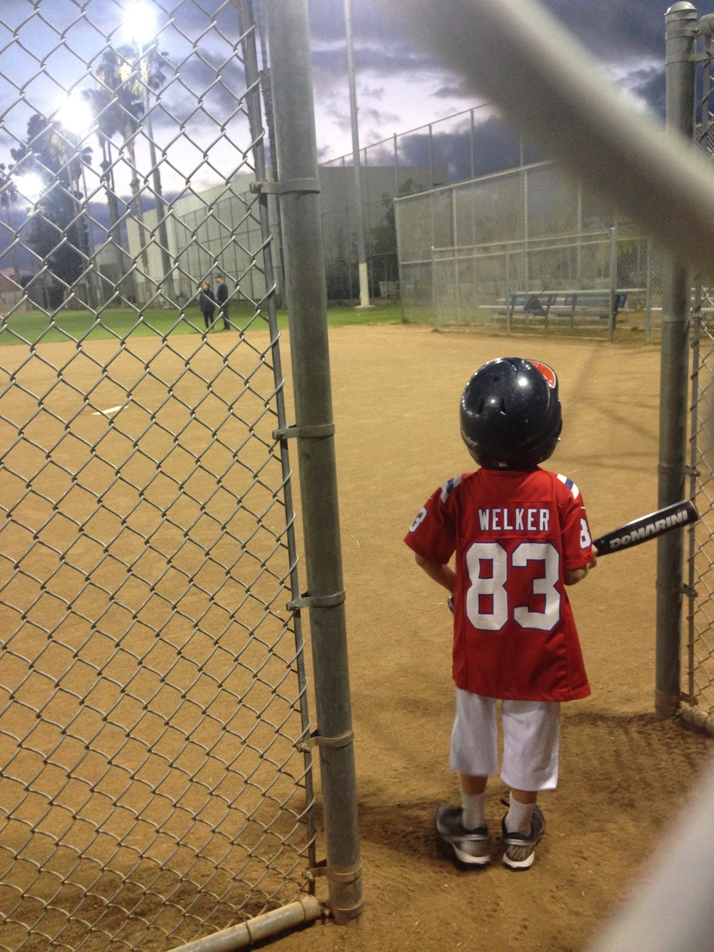 Wyatt's wearing his football jersey to his baseball practice!