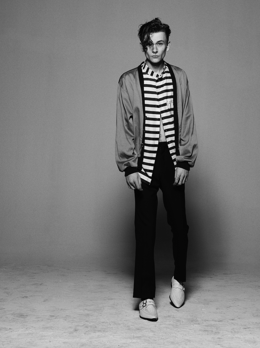Ryan wears shirt and cardigan by  Billy LA , trousers by  Dior Homme  and shoes by  Saint Laurent .