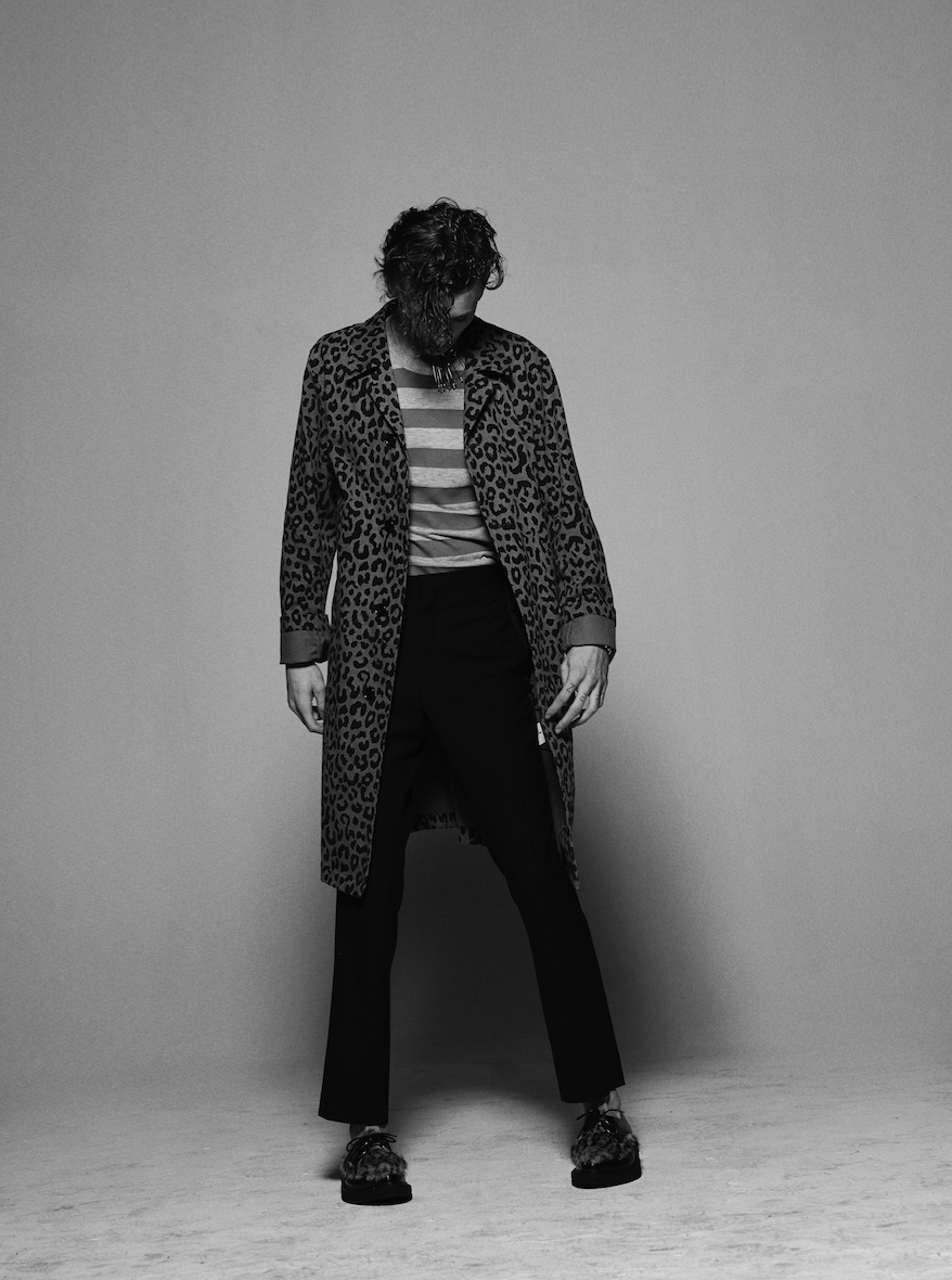 Ryan wears t-shirt by  Billy LA , trousers by  Dior Homme , coat by  Dries Van Noten , shoes by  Saint Laurent  and bracelet stylist's own.