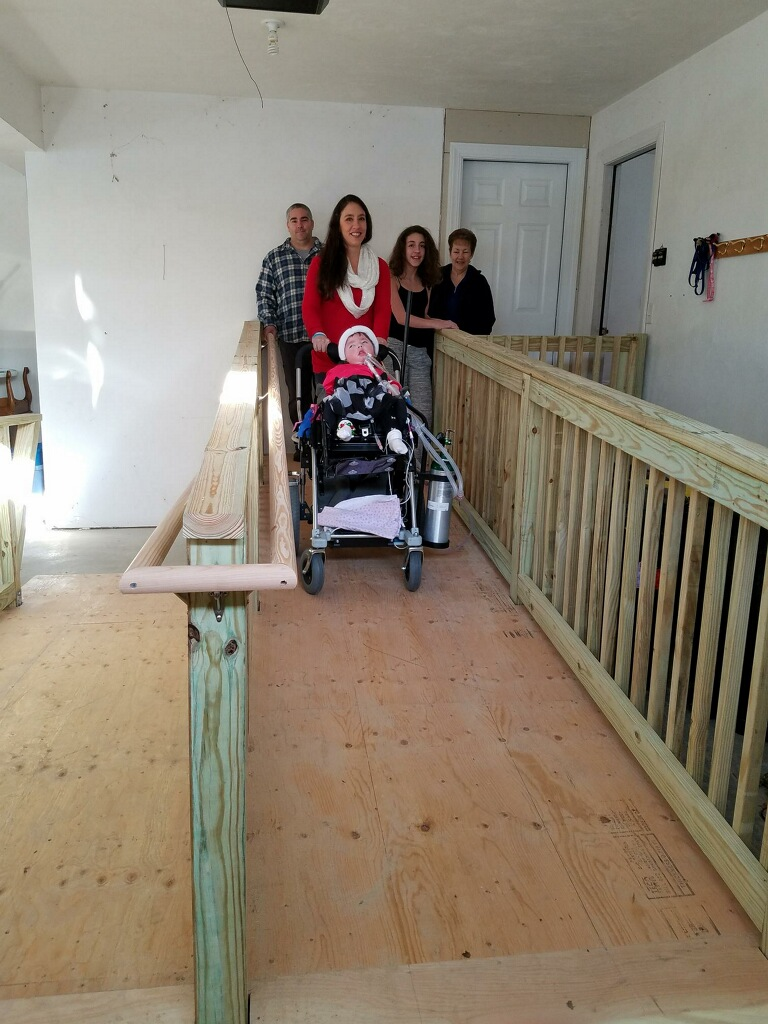 Leila, her family and a finished ramp!
