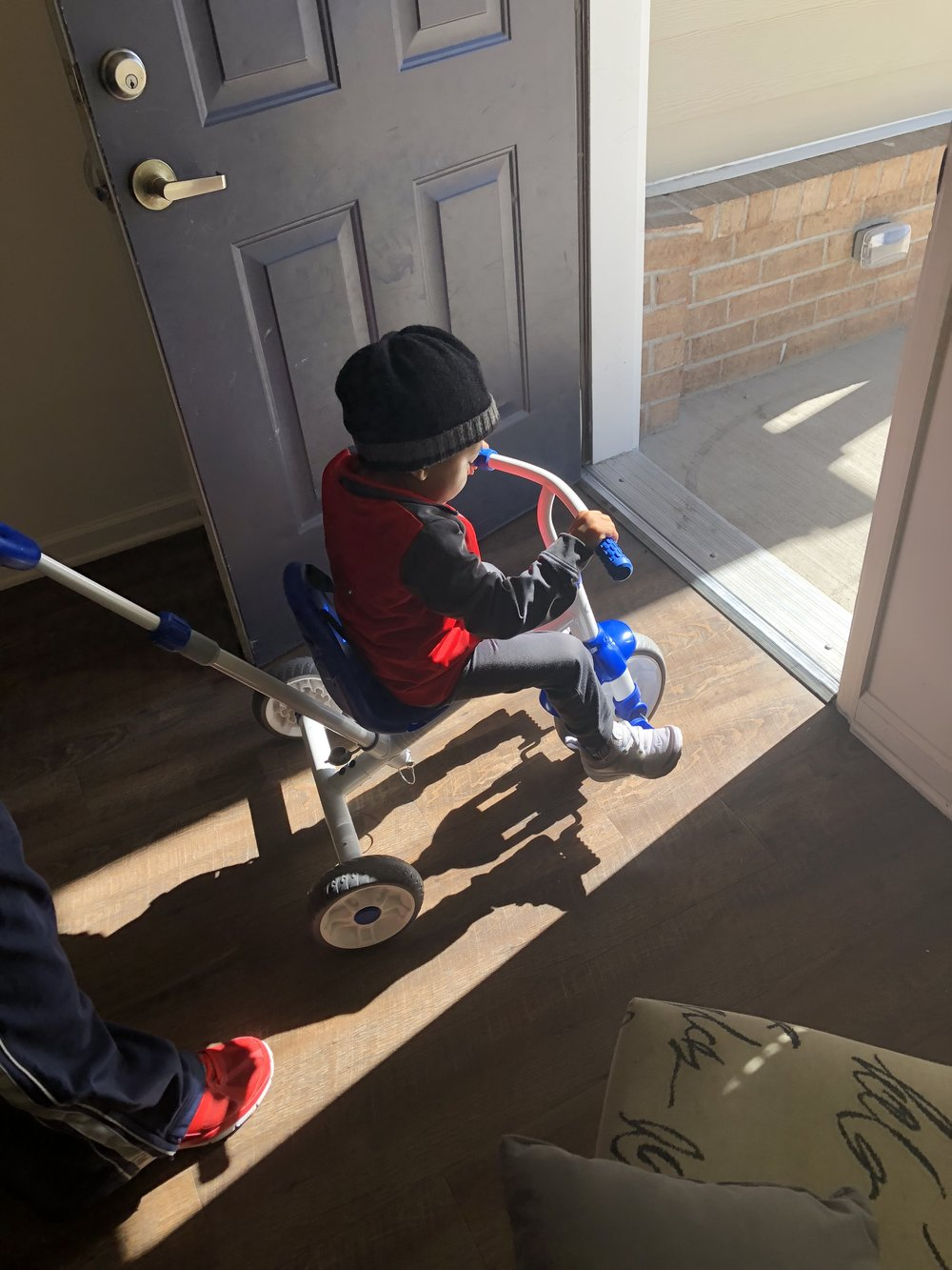 Time for an afternoon cruise on his new tricycle.