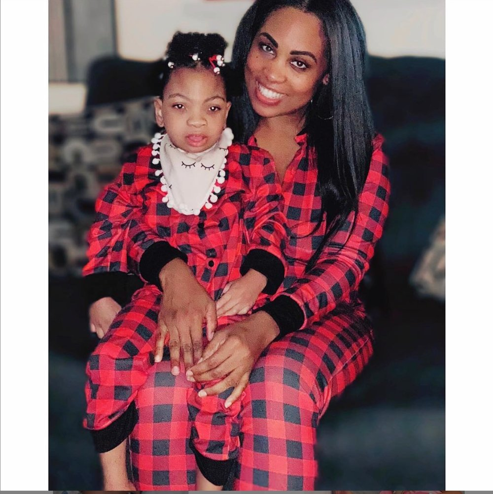 Christi Jo is picture perfect in her mother's arms at home in Los Angeles, CA on Christmas Eve.