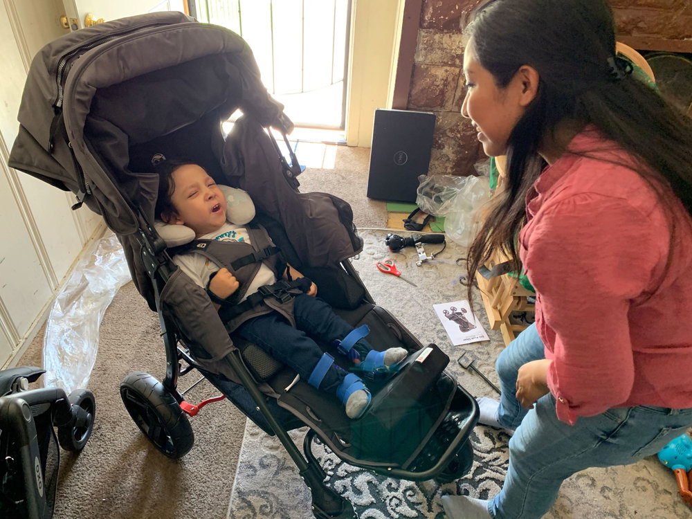 Matthew gets comfy in his brand new special needs stroller from Holton's Heroes.