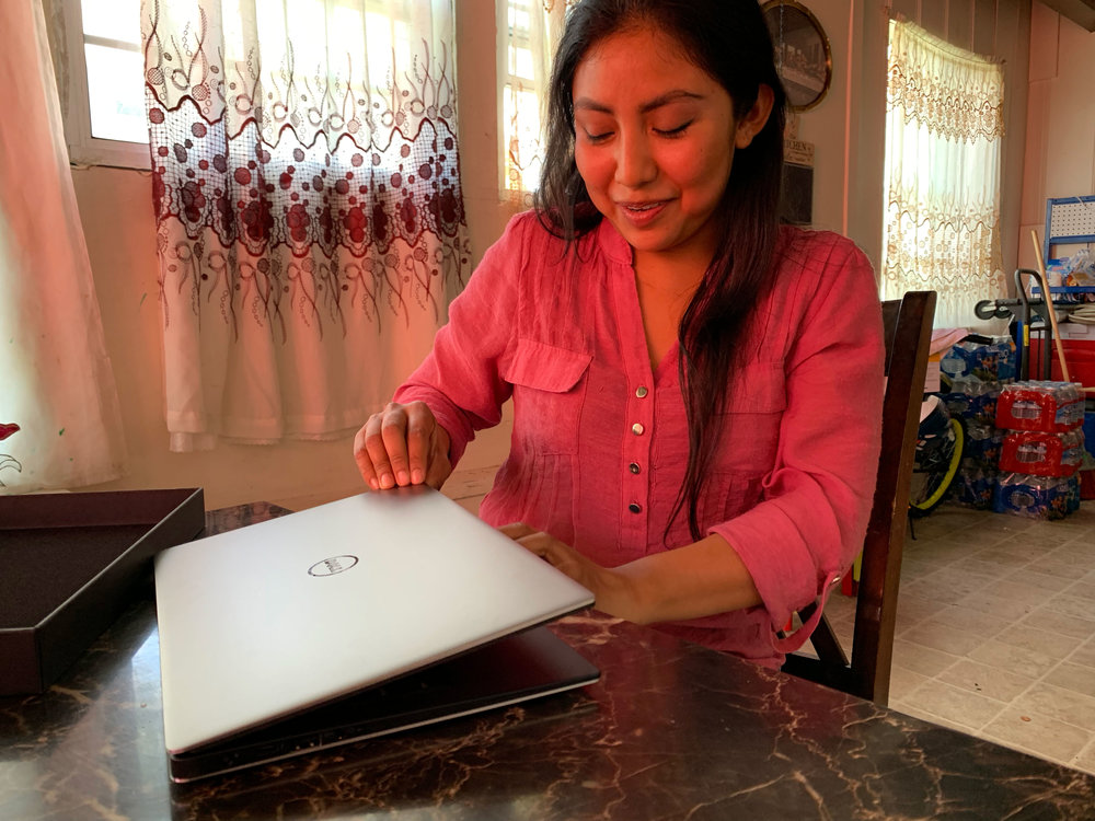 Ana opening her new laptop for the first time!