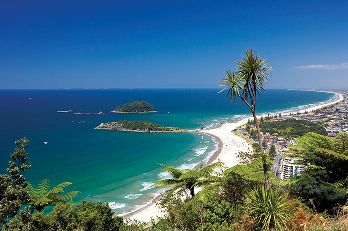 View from the summit of Mount Maunganui, which sits at the tip of the peninsula, dividing ocean from harbour, and after which this seaside destination is named. Image by Chris McLennan.